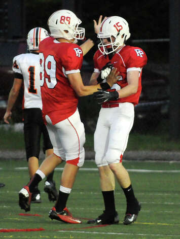 Prep's Andrew Ostrosky, left, congratulates John Dellisanti after he scores a touchdown as Fairfield Prep hosts Shelton High School in a football game at Fairfield University's Alumni Field in Fairfield, Conn., Oct. 5, 2012. Photo: Keelin Daly / Stamford Advocate