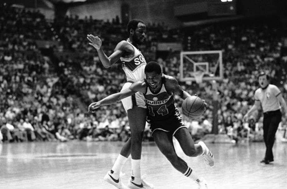 Tom Henderson: After a title with the Washington Bullets, wound down his career with the Rockets and another trip to the NBA Finals in 1981. (Associated Press)