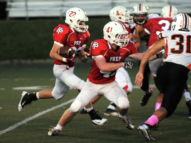 Prep's Joseph Ganim carries as Matthew Festa blocks as Fairfield Prep hosts Shelton High School in a football game at Fairfield University's Alumni Field in Fairfield, Conn., Oct. 5, 2012. Photo: Keelin Daly / Stamford Advocate