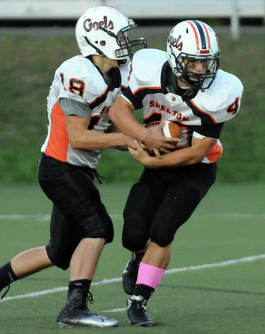 Shelton QB Mark Piccirillo hands the ball off to Jason Thompson as Fairfield Prep hosts Shelton High School in a football game at Fairfield University's Alumni Field in Fairfield, Conn., Oct. 5, 2012. Photo: Keelin Daly / Stamford Advocate