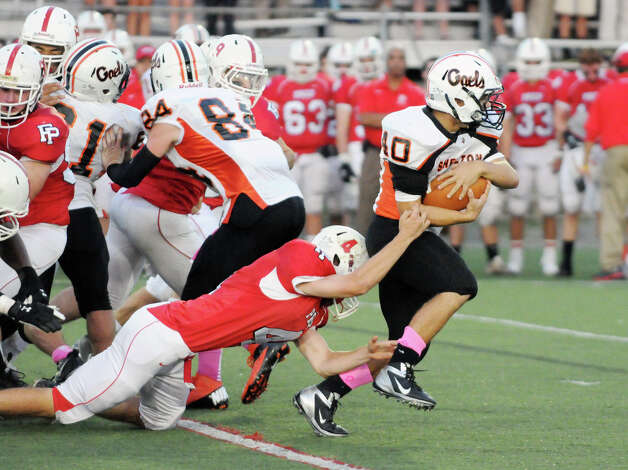 Shelton's Jason Thompson breaks through the Prep defensive line as Fairfield Prep hosts Shelton High School in a football game at Fairfield University's Alumni Field in Fairfield, Conn., Oct. 5, 2012. Photo: Keelin Daly / Stamford Advocate