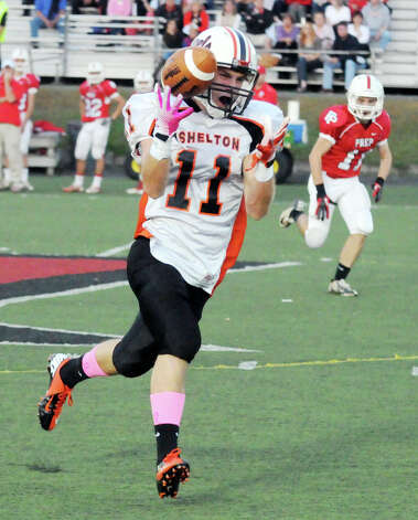 Shelton's Eddie Kochiss makes the catch as Fairfield Prep hosts Shelton High School in a football game at Fairfield University's Alumni Field in Fairfield, Conn., Oct. 5, 2012. Photo: Keelin Daly / Stamford Advocate
