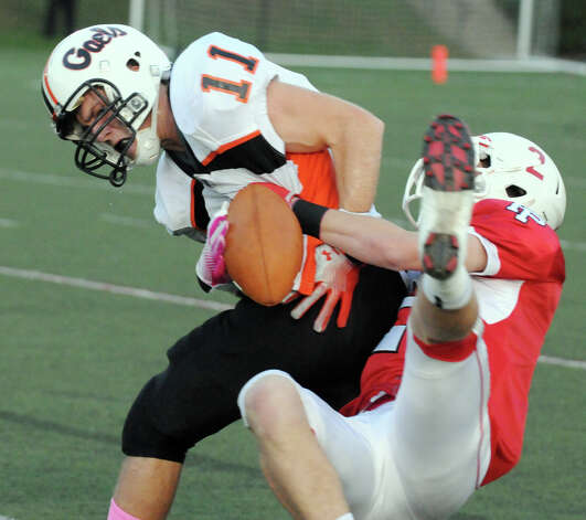Shelton's Eddie Kochiss is tackled by Prep's Colton Smith as Fairfield Prep hosts Shelton High School in a football game at Fairfield University's Alumni Field in Fairfield, Conn., Oct. 5, 2012. Photo: Keelin Daly / Stamford Advocate