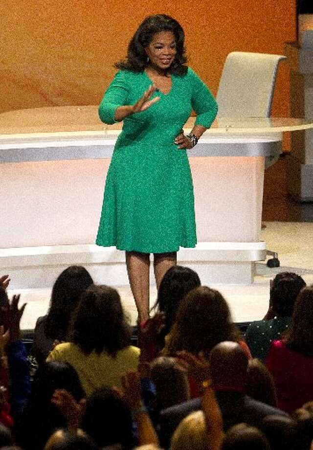"Winfrey waves to people in the first rows after her entrance. She is shooting two episodes of ""Oprah's Lifeclass"" with Osteen."