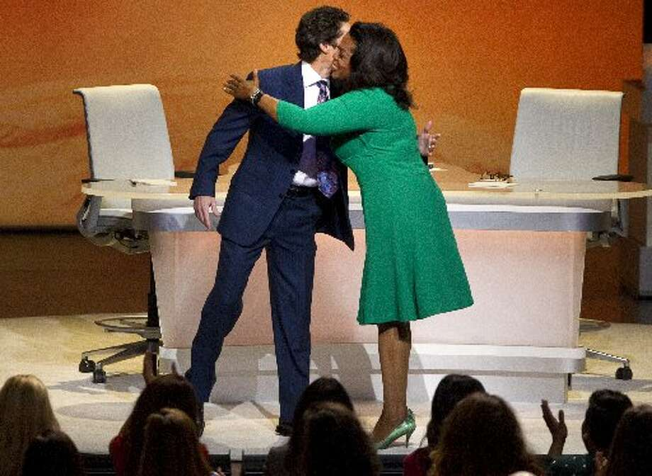 Joel Osteen is greeted by Winfrey before he preached positive thoughts to a wildly receptive crowd