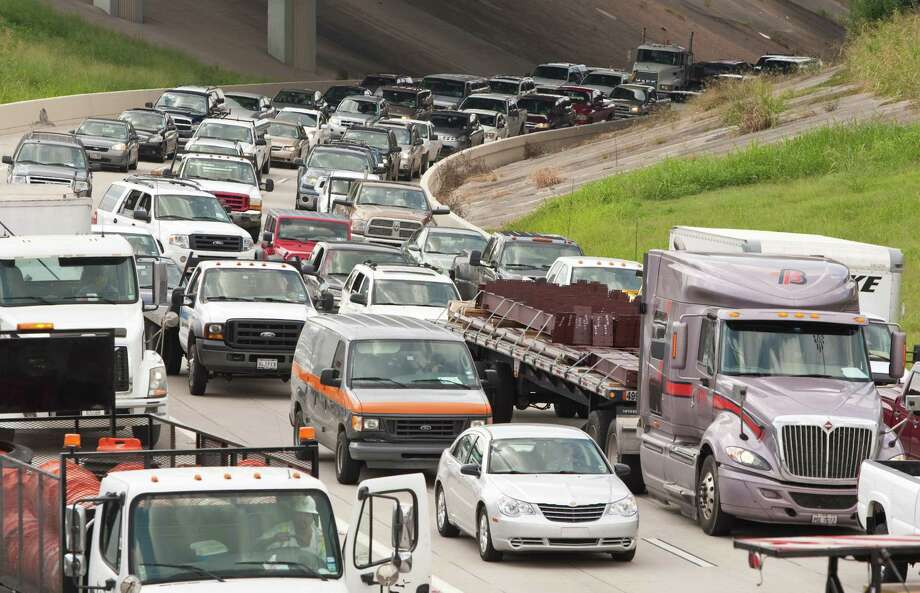 Traffic backs up as an 18-wheeler accident blocks four right lanes on I-10 east bound near Highway 59 Tuesday, Oct. 2, 2012, in Houston.  ( Nick de la Torre / Houston Chronicle ) Photo: Nick De La Torre / © 2012  Houston Chronicle
