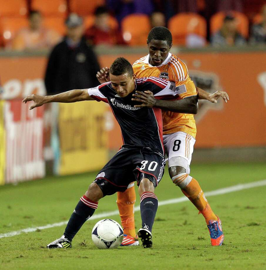 Kofi Sarkodie has gotten used to fighting to crack the Dynamo's starting lineup. The second-year defender will likely start against the Impact. Photo: Bob Levey / 2012 Getty Images