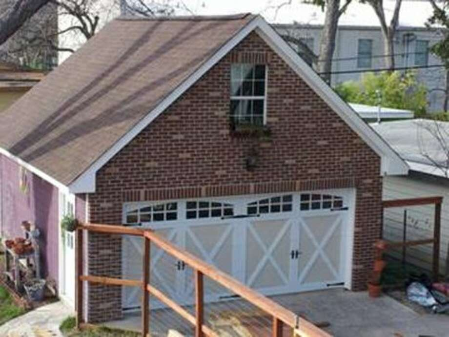 This two-car garage was constructed by Rhino Design Build at 142 Funston Place about two years ago. It includes a brick faade to comply with codes enforced by the areaÕs conservation district and storage space in both the ground floor and attic.