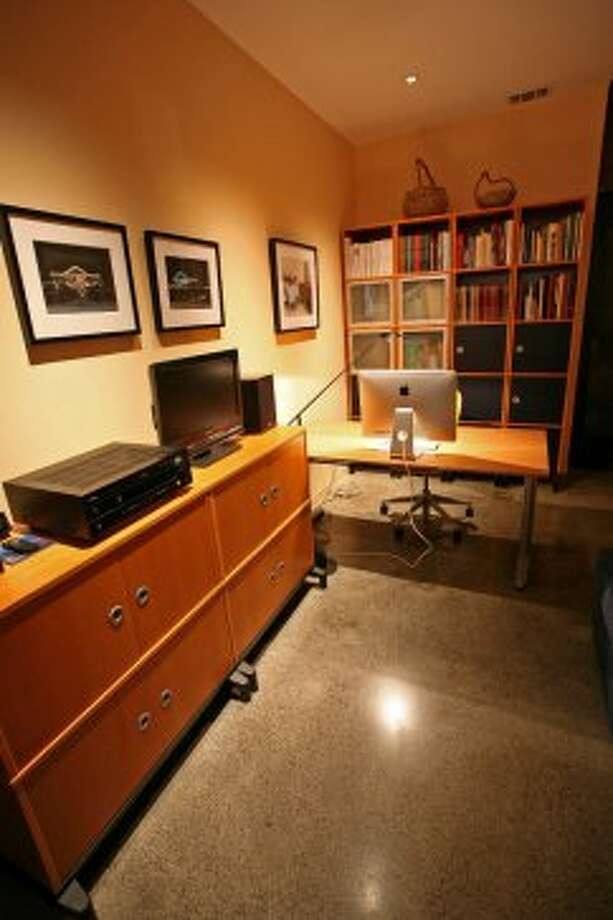 Julius Gribou uses the third bedroom as his office area,