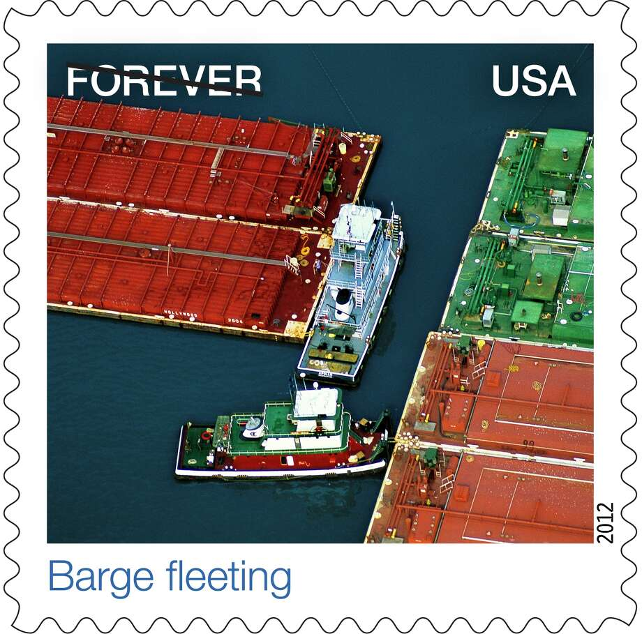 U.S. Postal Service stamp shows photograph by Jim Wark that was taken in the Old River Barge Fleeting area, just off the Houston Ship Channel.   Source: U.S. Postal Service