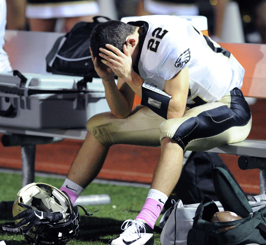 Liam Moore # 22 of Trumbull on the bench with his head in his hands during the boys high school football game between Greenwich High School and Trumbull High School at Greenwich, Friday afternoon, Oct. 5, 2012. Photo: Bob Luckey / Greenwich Time