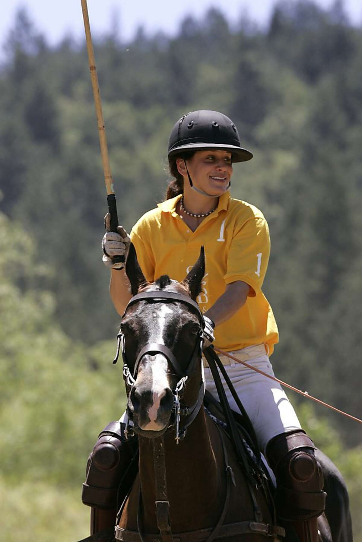 Elizabeth Goodwin Welborn, creative director of Stick & Ball, and her horse, Buford, at Wine Country Polo Club in Santa Rosa.