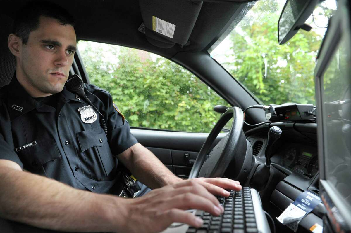 Coeymans Police Officer Peter Zownir uses the in-car computer during his shift on Thursday afternoon, Oct. 4, 2012 in Coeymans, NY. Zownir is a part time officer for the town. (Paul Buckowski / Times Union)