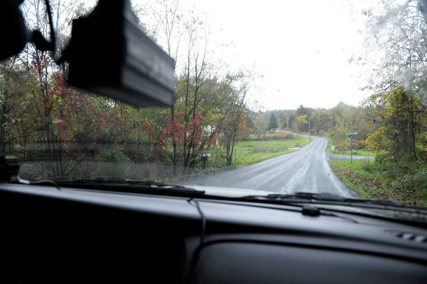 Coeymans Police Officer Peter Zownir heads down a road in a rural section of town during his shift on Thursday afternoon, Oct. 4, 2012 in Coeymans, NY. Zownir is a part time officer for the town. (Paul Buckowski / Times Union)