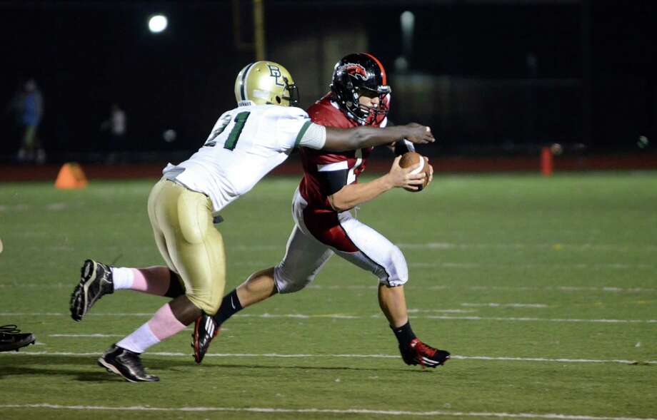 Warde's Max Garrett (11) carries the ball as Bassick's Jeri Kollack (21) defends during the football game at Tetreau/Davis Field at Fairfield Warde High School on Friday, Oct. 5, 2012. Photo: Amy Mortensen / Connecticut Post Freelance
