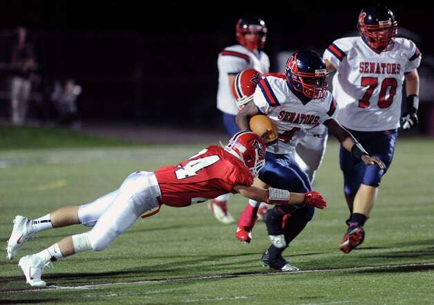 Brien McMahon's Trevon Forney carries the ball during Friday's game at New Canaan on October 5, 2012. Photo: Lindsay Niegelberg / Stamford Advocate