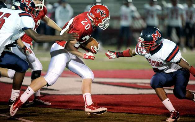 New Canaan's Andrew Read carries the ball during Friday's game against Brien McMahon High School at New Canaan on October 5, 2012. Photo: Lindsay Niegelberg / Stamford Advocate