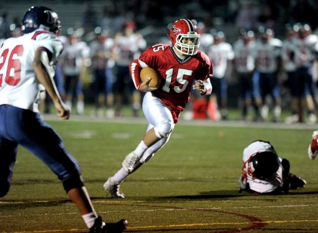 New Canaan's Nick Cascione carries the ball during Friday's game against Brien McMahon High School at New Canaan on October 5, 2012. Photo: Lindsay Niegelberg / Stamford Advocate