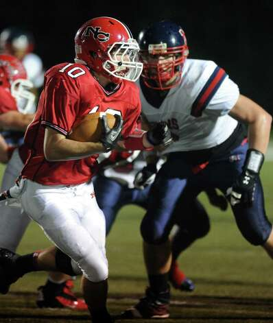 New Canaan's Louis Hagopian carries the ball during Friday's game against Brien McMahon High School at New Canaan on October 5, 2012. Photo: Lindsay Niegelberg / Stamford Advocate