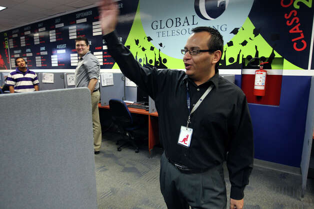 Jaime Amaro, 39, oversees his crew of telemarketers at Global Telesourcing in Monterrey, Mexico. Amaro, born in Mexico, grew up in Houston but decided to move back to Monterrey. He started at the company as a telemarketer and worked his way up to director. Photo: Jerry Lara, San Antonio Express-News / © 2012 San Antonio Express-News