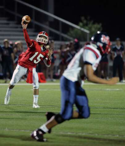 New Canaan's Nick Cascione throws a pass during Friday's game against Brien McMahon High School at New Canaan on October 5, 2012. Photo: Lindsay Niegelberg / Stamford Advocate