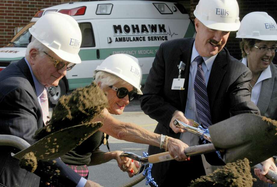 Neil Golub, left, his wife Jane Golub, center, and James W. Connolly, President and Chief Executive Officer of Ellis Medicine, join other local dignitaries during a ground breaking for the new Golub Center for Emergency Care at Ellis Hospital in Schenectady, NY Friday Oct. 5, 2012. (Michael P. Farrell/Times Union) Photo: Michael P. Farrell
