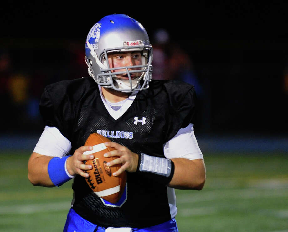 Bunnell QB Bryan Castelot looks to throw a pass, during boys football action against Masuk in Stratford, Conn. on Friday October 5, 2012. H sent this pass to teammate Justin Townsend which resulted in a touchdown. Photo: Christian Abraham / Connecticut Post