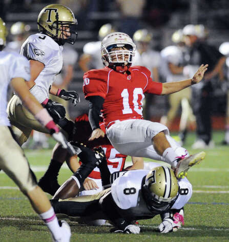 Greenwich kicker Jesse Adelberg # 10 gets hit and injured by Trumbull's Tyler McBurnie # 8 on an extra attempt during the boys high school football game between Greenwich High School and Trumbull High School at Greenwich, Friday afternoon, Oct. 5, 2012. Photo: Bob Luckey / Greenwich Time