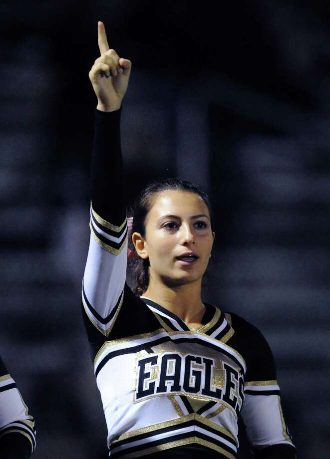 Trumbull cheerleader Jessica Pikikero cheers during the boys high school football game between Greenwich High School and Trumbull High School at Greenwich, Friday afternoon, Oct. 5, 2012. Photo: Bob Luckey / Greenwich Time