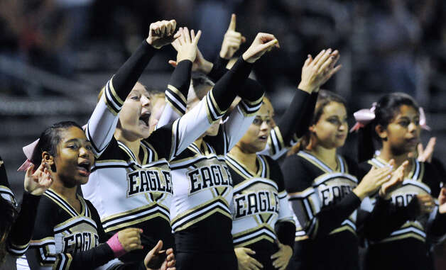 The Trumbull High School cheerleading squad during the boys high school football game between Greenwich High School and Trumbull High School at Greenwich, Friday afternoon, Oct. 5, 2012. Photo: Bob Luckey / Greenwich Time