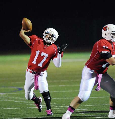 Greenwich quarterback Jose Melo # 17 throws during the boys high school football game between Greenwich High School and Trumbull High School at Greenwich, Friday afternoon, Oct. 5, 2012. Photo: Bob Luckey / Greenwich Time