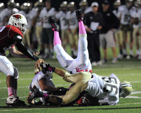 Tyler Barr # 56 of Trumbull upends a Greenwich runner during boys high school football game between Greenwich High School and Trumbull High School at Greenwich, Friday afternoon, Oct. 5, 2012. Photo: Bob Luckey / Greenwich Time