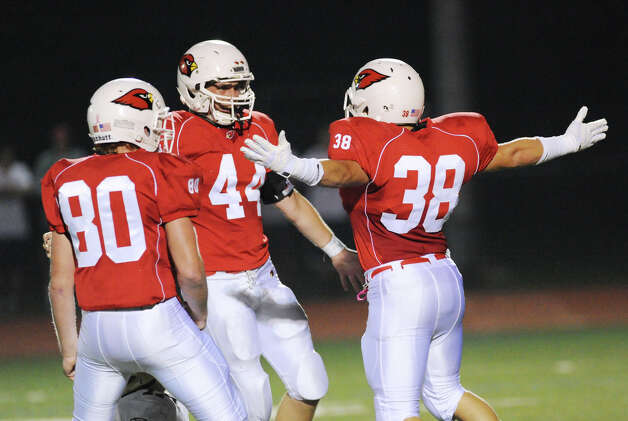 Greenwich players celebrate, they are from left, Joe Kelly # 80, Patrick Callahan, # 44, and Daniel Claroni # 38 during the boys high school football game between Greenwich High School and Trumbull High School at Greenwich, Friday afternoon, Oct. 5, 2012. Photo: Bob Luckey / Greenwich Time