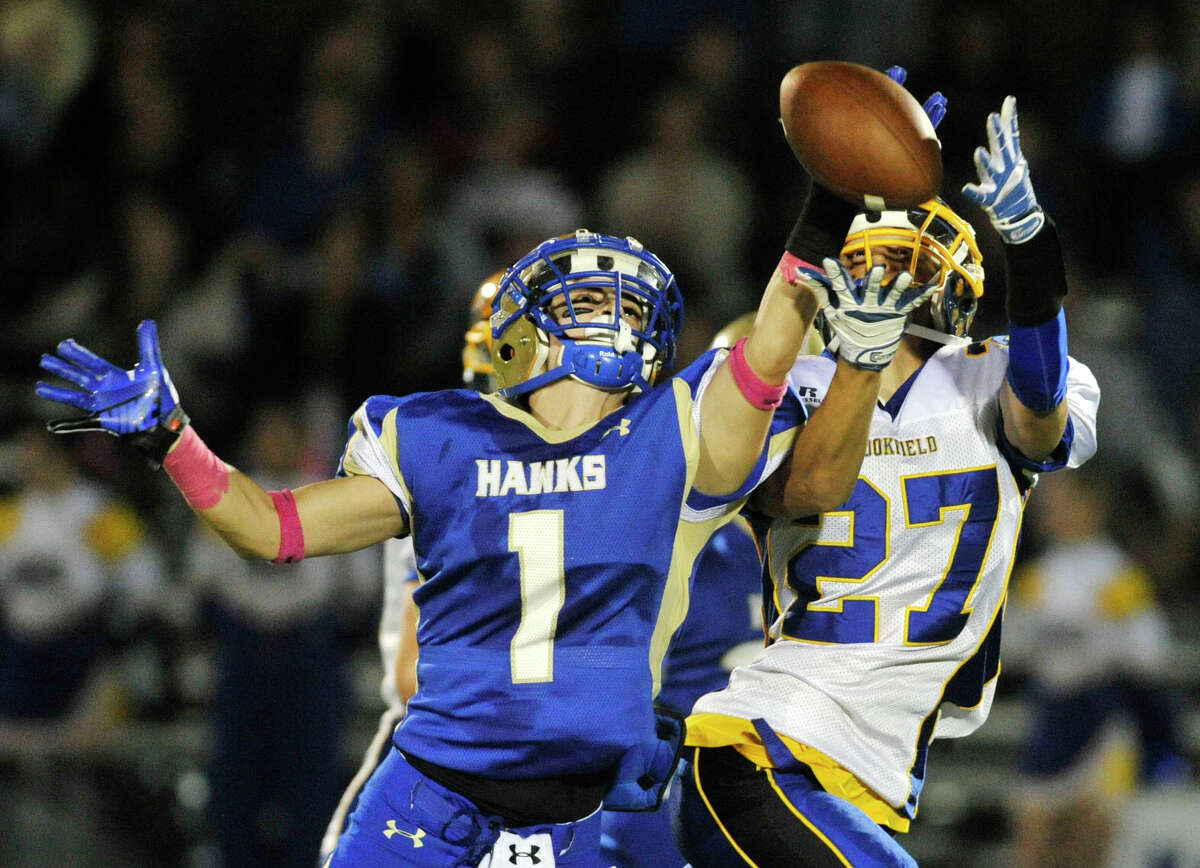 Newtown's Justin DeVellis breaks up a pass intended for Brookfield's Nick Biasetti during their game at Newtown High School on Friday, Oct. 5, 2012. Newtown won, 35-7.