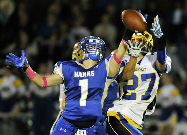 Newtown's Justin DeVellis breaks up a pass intended for Brookfield's Nick Biasetti during their game at Newtown High School on Friday, Oct. 5, 2012. Newtown won, 35-7. Photo: Jason Rearick / The News-Times