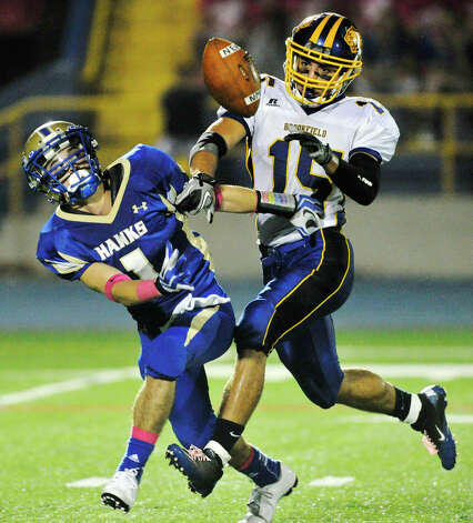 Brookfield's Casey Burdick breaks up a pass intended for Newtown's Justin DeVellis during their game at Newtown High School on Friday, Oct. 5, 2012. Newtown won, 35-7. Photo: Jason Rearick / The News-Times