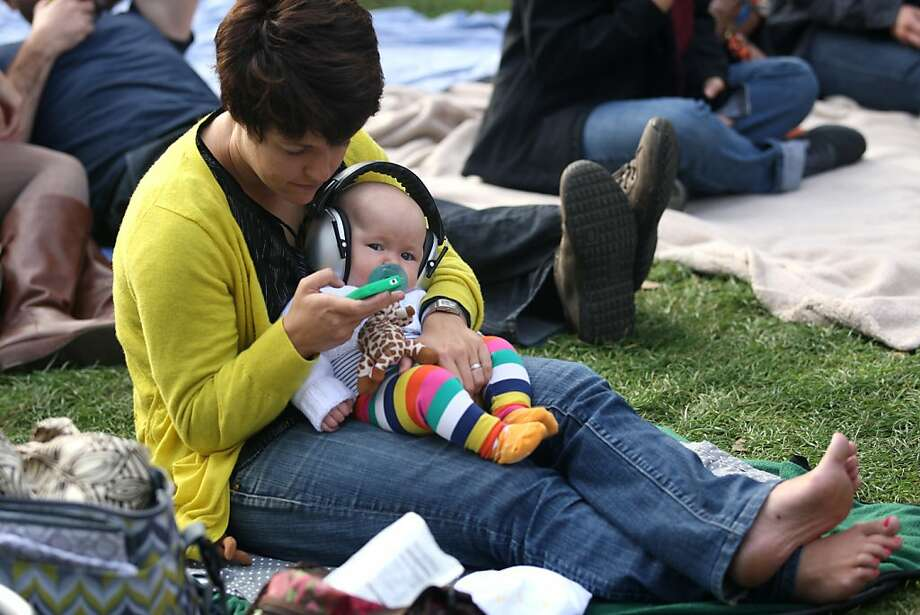 """Meredith Kinney and her four and a half month old Dahlia enjoy a break between sets at Hardly Strictly Bluegrass in Golden Gate Park on October 5, 2012. """"This is my favorite weekend of the year,"""" said Meredith. """"Dahlia was here last year too, but she was a little more inclosed."""" Photo: Luanne Dietz, The Chronicle"""
