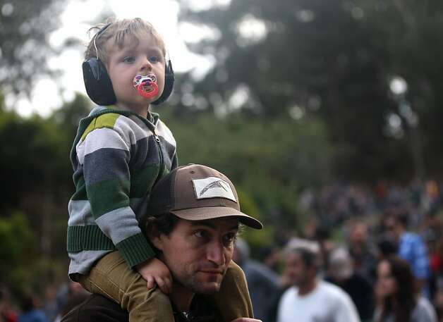 "3-year old Bodhi Hunt sits on the shoulders of his dad, Drev Hunt, Friday October 5, 2012 at Hardly Strictly Bluegrass in Golden Gate Park. ""We come every year, and when these guys came along we just kept coming,"" Drev said. Photo: Luanne Dietz, The Chronicle"