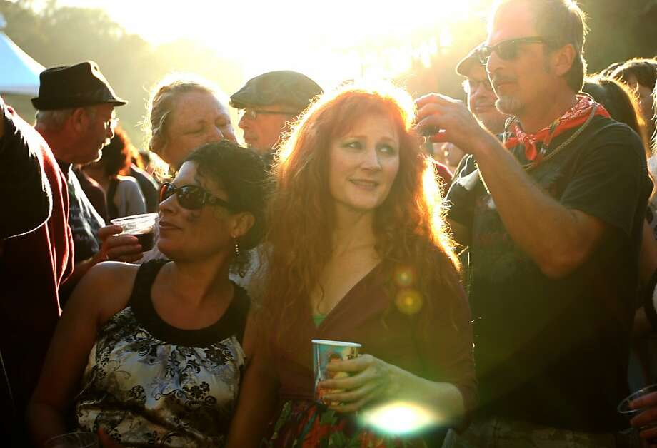 Fans listen to Elvis Costello performs the last show of the night to wrap up the first day of Hardly Strictly Bluegrass on October 5, 2012 in Golden Gate Park. Photo: Luanne Dietz, The Chronicle