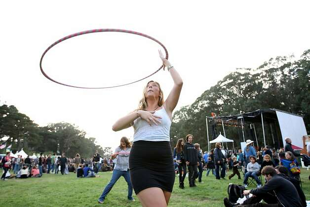 "Bluegrass fan Carla Pecoraro twirls a Hula Hoop outside the Arrow Stage at Hardly Strictly Bluegrass on Golden Gate Park on October 5, 2012. Pecoraro said she has been twirling for two months. ""I just feel the timing perfectly, it's just how it is,"" she said. Photo: Luanne Dietz, The Chronicle"