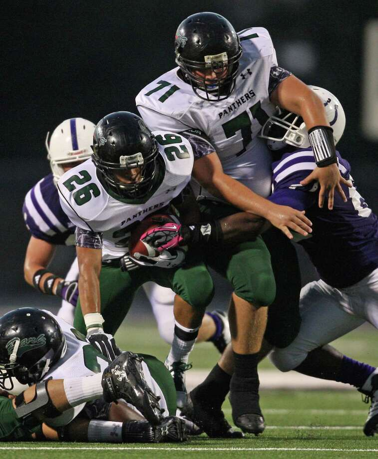 Dayton 35, Kingwood Park 14Kingwood Park's Jhalen Demming (26) rushes the ball as teammate Cason Mayo (71) provides a block during the first half of a high school football game against Dayton, Friday, October 5, 2012 at Bronco Stadium in Dayton, TX. Photo: Eric Christian Smith, For The Chronicle