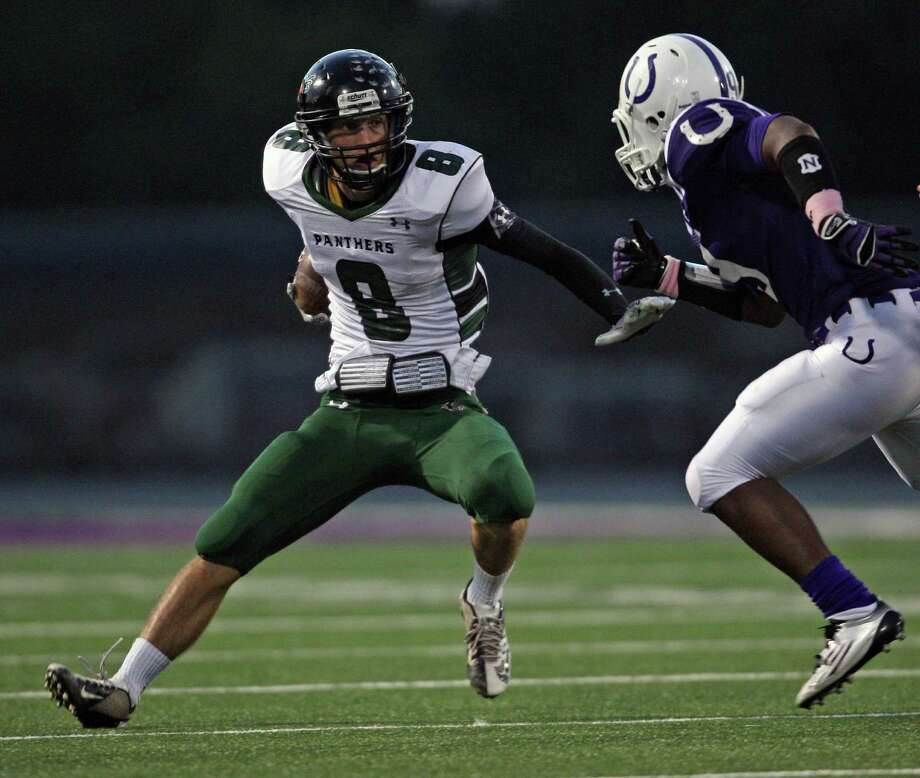 Kingwood Park's Caleb Lewallen (8) changes direction as Dayton's Brandon McBride closes in during the first half of a high school football game, Friday, October 5, 2012 at Bronco Stadium in Dayton, TX. Photo: Eric Christian Smith, For The Chronicle