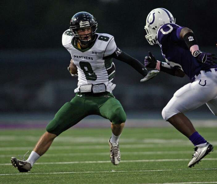Kingwood Park's Caleb Lewallen (8) changes direction as Dayton's Brandon McBride closes in during th