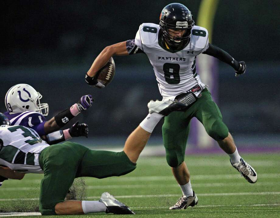Kingwood Park's Caleb Lewallen (8) avoids the tackle of Dayton's Brandon McBride during the first half of a high school football game, Friday, October 5, 2012 at Bronco Stadium in Dayton, TX. Photo: Eric Christian Smith, For The Chronicle