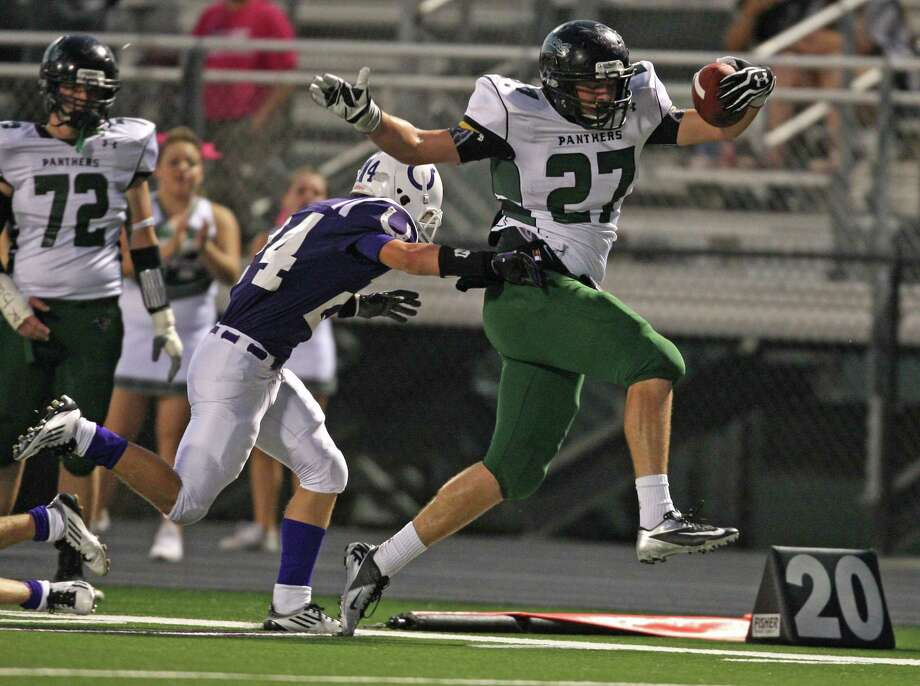 Kingwood Park's Jordan Feuerbacher (27) tries to gain extra yardage before being pushed out of bounds by Dayton's Heath Hancock during the first half of a high school football game, Friday, October 5, 2012 at Bronco Stadium in Dayton, TX. Photo: Eric Christian Smith, For The Chronicle