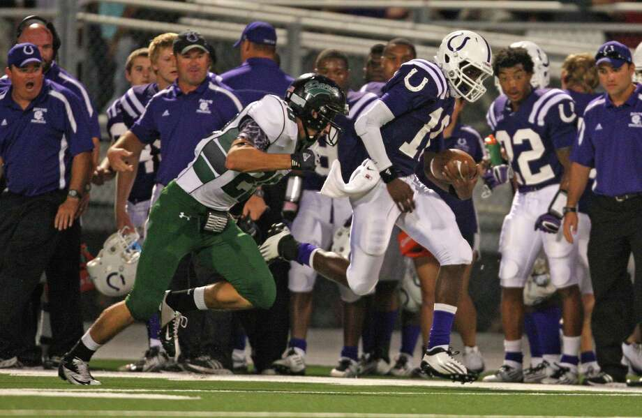 Dayton's Markain Chambers (right) rushes past Kingwood Park's Jonathan Ducof for a touchdown during the first half of a high school football game, Friday, October 5, 2012 at Bronco Stadium in Dayton, TX. Photo: Eric Christian Smith, For The Chronicle