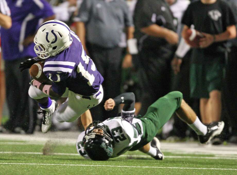Dayton's Ryan McBride (left) is tackled by Kingwood Park's Chris Comeaux during the first half of a high school football game, Friday, October 5, 2012 at Bronco Stadium in Dayton, TX. Photo: Eric Christian Smith, For The Chronicle