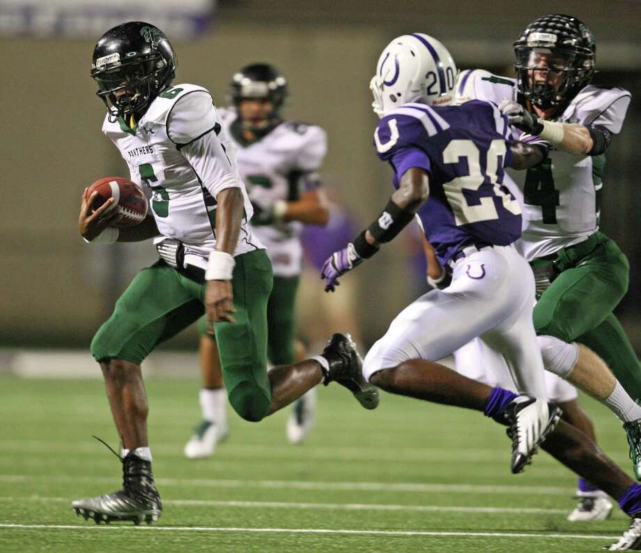 Kingwood Park's Jaylon Henderson (6) rushes past Dayton's Jacarius Keener during the first half of a high school football game, Friday, October 5, 2012 at Bronco Stadium in Dayton, TX. Photo: Eric Christian Smith, For The Chronicle