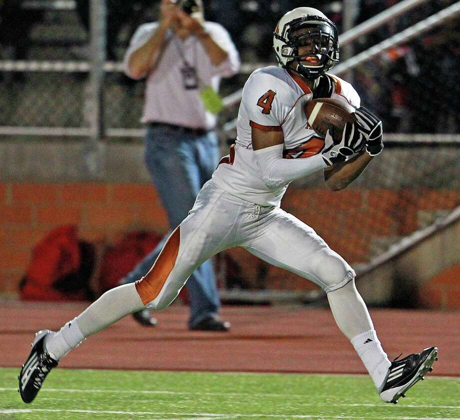 Byron Daniels catches a long pass in the second quarter as Madison plays Roosevelt at Heroes Stadium on October 5, 2012. Photo: Tom Reel, Express-News / ©2012 San Antono Express-News