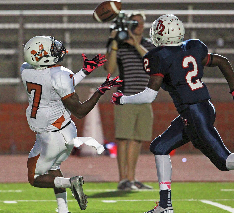 Running back Marquis Warford surprises the defense, getting past James Malone to haul in a long touchdpwn reception as Madison plays Roosevelt at Heroes Stadium on October 5, 2012. Photo: Tom Reel, Express-News / ©2012 San Antono Express-News